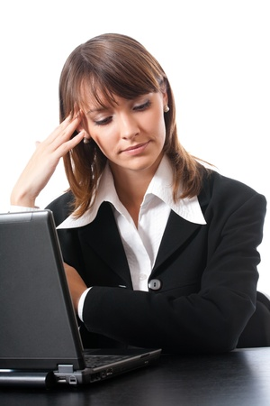 office use: Unhappy serious thinking young businesswoman with laptop, isolated over white background Stock Photo
