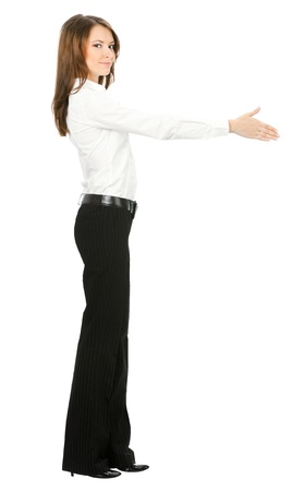 Full body of happy smiling young beautiful business woman giving hand for handshake, isolated over white background photo