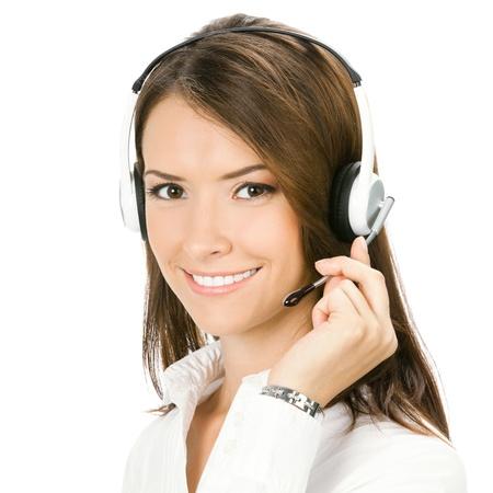 白い背景で隔離のヘッドセットでの笑みを浮かべて明るく美しい若い顧客サポート電話オペレーターは幸せのポートレート