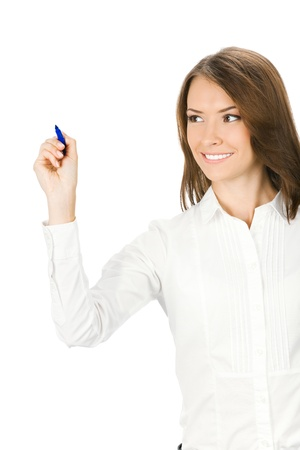 copy writing: Happy smiling cheerful young business woman writing or drawing something on screen with blue marker, isolated on white background