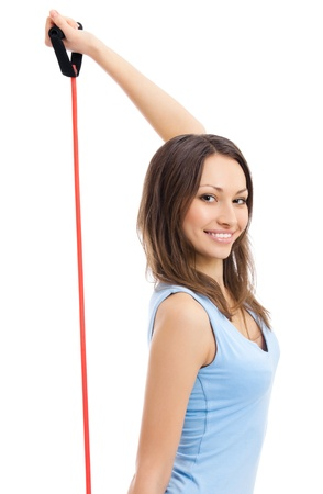 Young happy smiling woman dowing fitness exercise with expander, isolated over white background photo