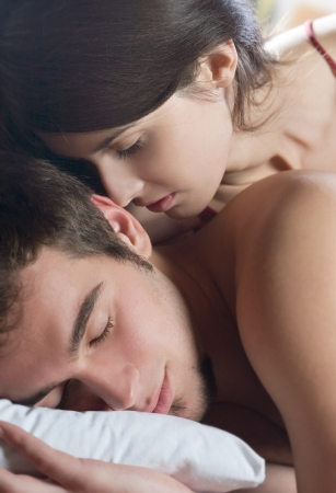 sex tenderness: Young beautiful amorous couple making love in bed