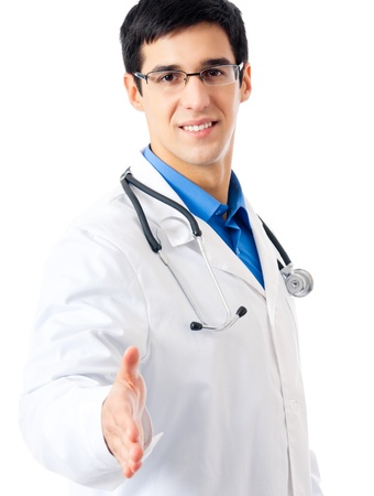 Portrait of happy smiling young doctor giving hand for handshake, isolated over white background photo