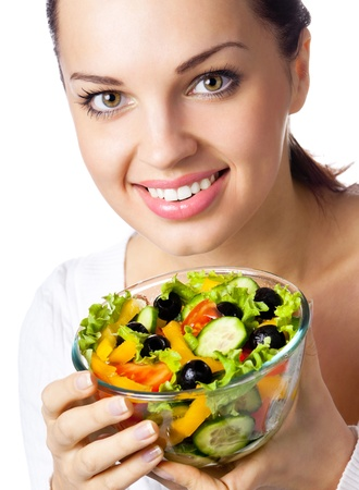Happy smiling cheerful young woman with vegetarian salad, isolated over white background photo