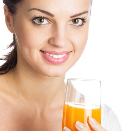 Portrait of happy smiling girl with glass of orange juice, isolated over white background Stock Photo - 14158697