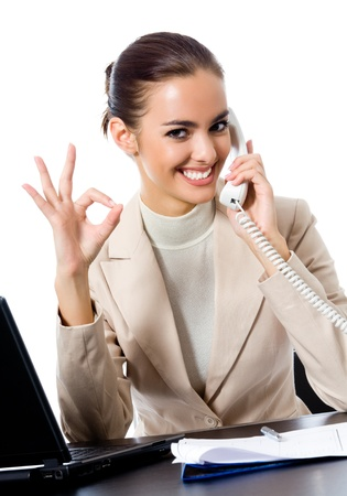 business woman phone: Business woman with phone showing thumbs up sign, at office, isolated over white background Stock Photo