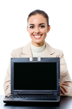 Smiling young business woman showing laptop with copyspace area, isolated on white photo