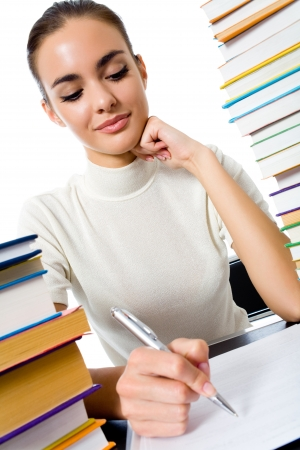 Writing woman with textbooks, isolated over white background photo