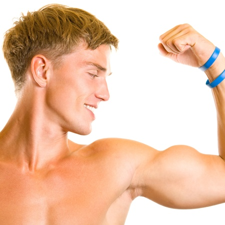 only the biceps: Portrait of happy smiling muscular young man showing biceps, isolated over white background Stock Photo