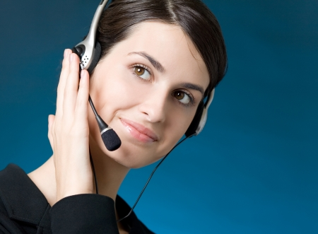 Portrait of happy smiling cheerful customer support phone operator in headset, over blue background Stock Photo - 14709270