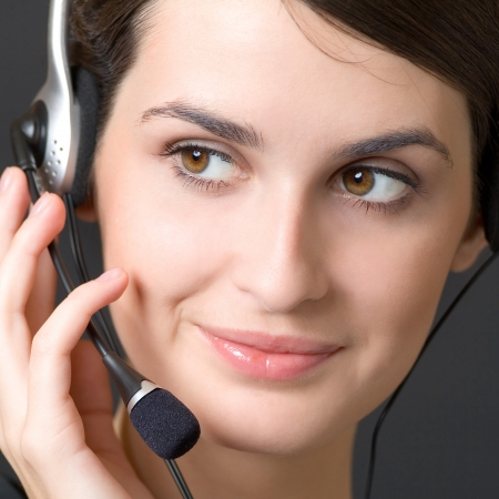 Portrait of happy smiling cheerful customer support phone operator in headset Stock Photo - 14709272