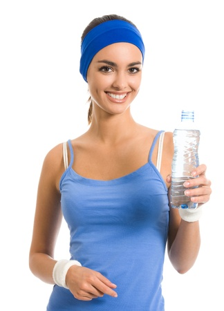 Portrait of cheerful young attractive woman in fitness wear drinking water, isolated over white background photo