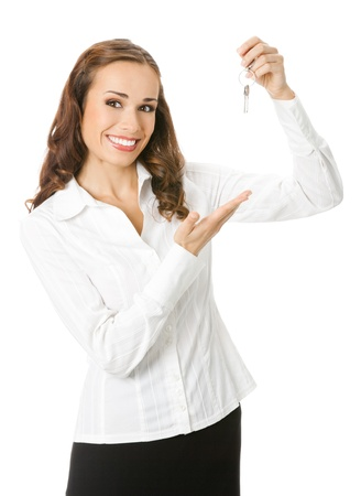 Young happy smiling business woman or real estate agent showing keys from new house, isolated over white background Stock Photo - 15187883