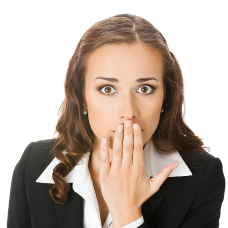 hand over: Portrait of happy smiling young business woman covering with hand her mouth, isolated over white background