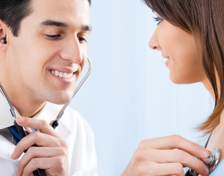 Doctor examing female patient with stethoscope in hospital Stock Photo - 15187924