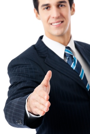 Happy smiling young business man giving hand for handshake, isolated over white background  Focus on hand  photo