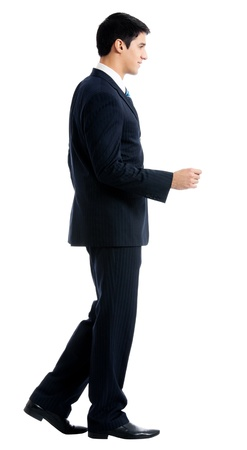 important people: Full body portrait of walking young business man, isolated over white background