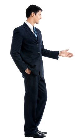 Full body of happy smiling young business man giving hand for handshake, isolated over white background photo