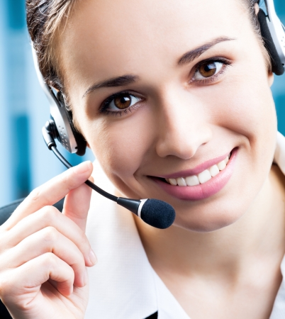 handsfree telephone: Portrait of happy smiling cheerful support phone operator in headset at office