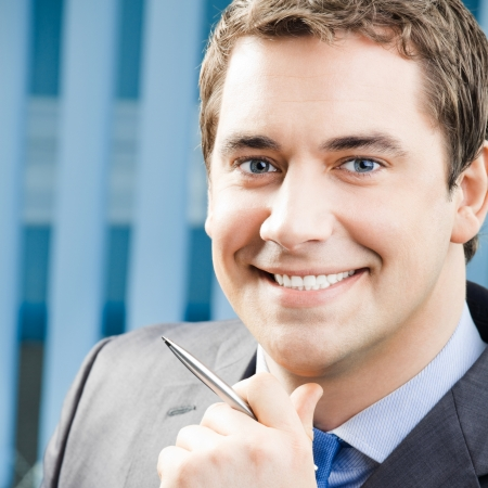 Portrait of happy smiling cheerful business man at office photo