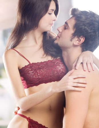 adult sex: Young beautiful amorous couple making love in bed