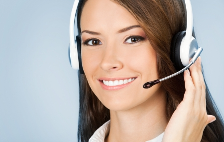 Portrait of happy smiling cheerful customer support phone operator in headset, over blue background photo