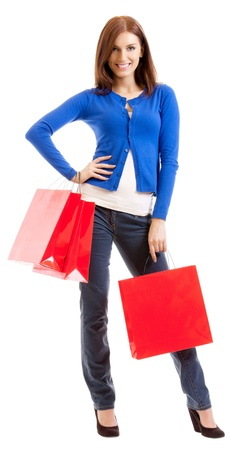 Cheerful smiling woman with red shopping bags, isolated over white background photo