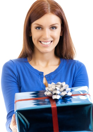 Cheerful woman showing gift, isolated over white background Stock Photo - 15025669