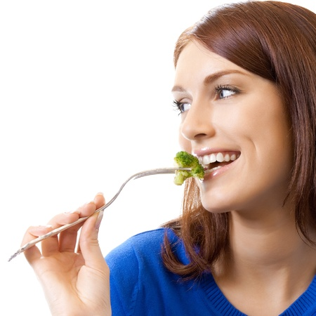 Portrait of cheerful woman eating broccoli, isolated over white background photo