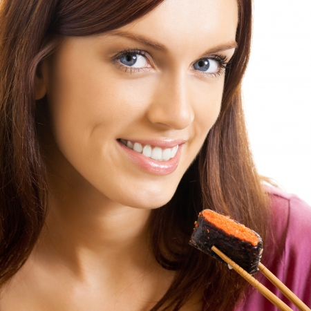 Portrait of cheerful beautiful woman eating sushi roll with chopsticks, isolated over white background photo