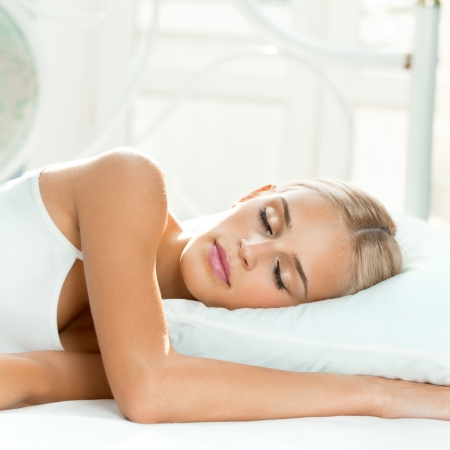 sleeping room: Young beautiful blond woman sleeping on bed Stock Photo