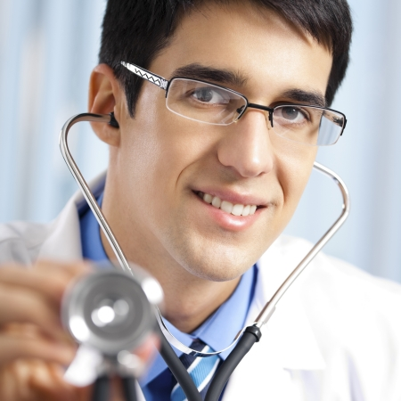 Happy smiling young doctor with stethoscope, at office Stock Photo - 15068865