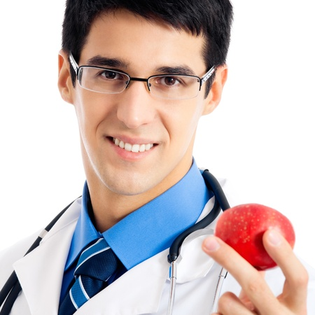 Portrait of happy smiling doctor giving apple, isolated over white background photo