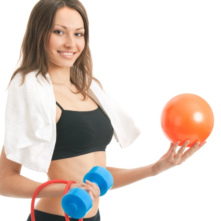 Portrait of happy smiling young woman in fitness wear with ball, isolated over white background photo