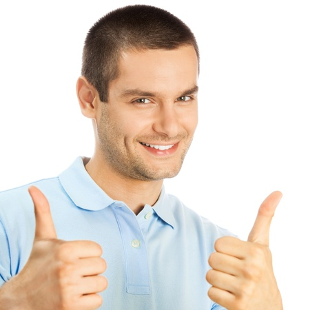 Portrait of cheerful young man showing thumbs up gesture, isolated over white background photo