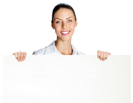 Cheerful business woman showing blank signboard, isolated over white background photo