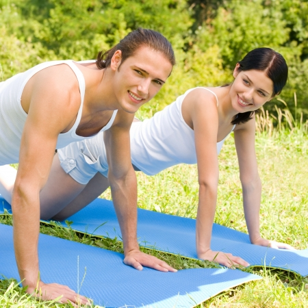 Cheerful young smiling couple on outdoor fitness workout photo