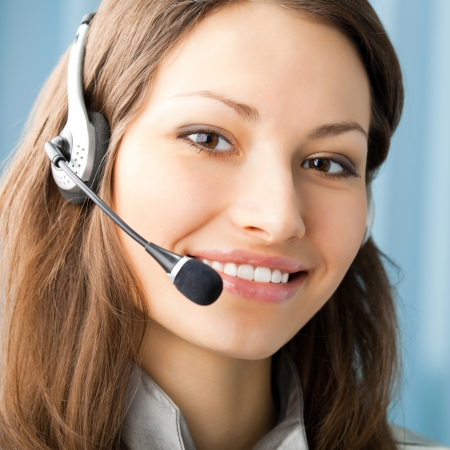 operators: Young cheerful smiling support phone female operator in headset at office