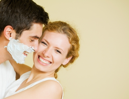 shave: Cheerfull couple having a fun together Stock Photo