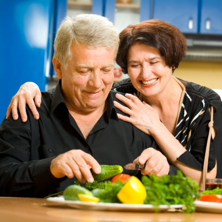 Cheerful senior couple cooking at home together Stock Photo - 15473272