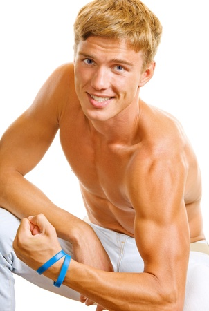 bicep: Portrait of happy smiling muscular young man showing biceps, isolated over white background Stock Photo
