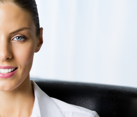 Closeup portrait of happy smiling businesswoman at office, with copyspace photo