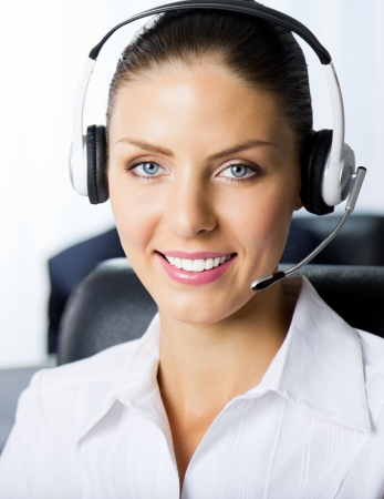 Portrait of female support phone operator at workplace photo