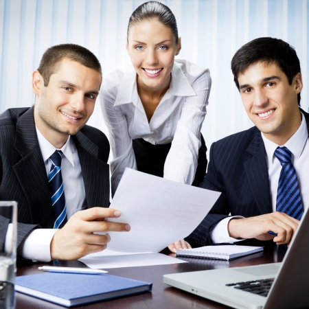 Three businesspeople working with document at office Stock Photo - 15540626