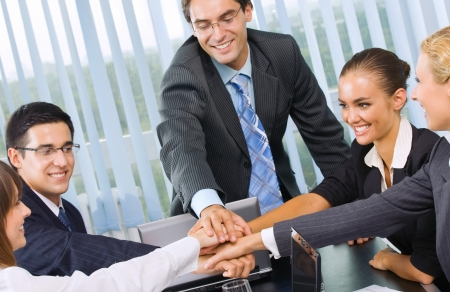 team working together: Happy successful five businesspeople at office