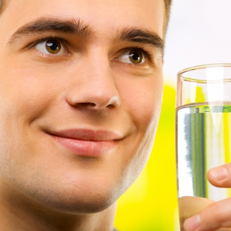 Portrait of happy smiling man drinking water, outdoor photo