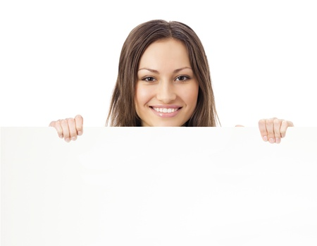 Happy smiling young beautiful woman showing blank signboard, isolated over white background photo