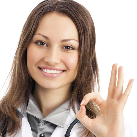 Happy smiling young female doctor with okay gesture, isolated over white background Stock Photo - 15920625
