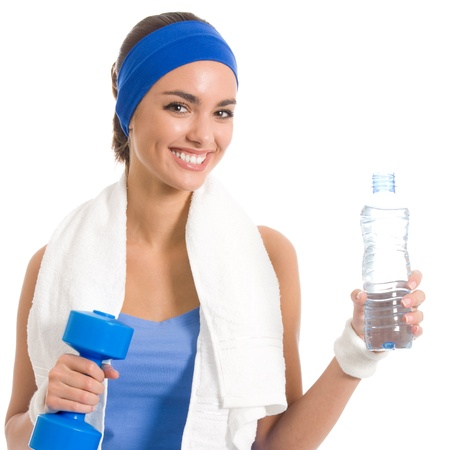 Portrait of cheerful young attractive woman in fitness wear with dumbbell and water, isolated over white background photo