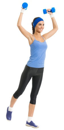 sport wear: Full body of cheerful woman in fitness wear exercising with dumbbells, isolated over white background